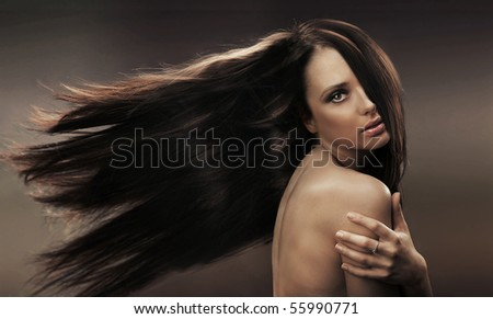 Portrait of a long haired brunette - stock photo