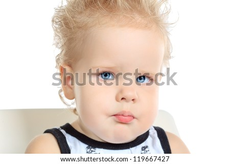 Portrait of a lovely baby boy. Isolated over white background.