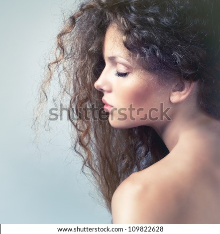 Portrait of a lovely blonde with eyes closed - stock photo