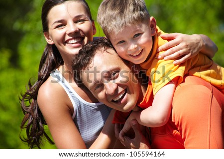 Portrait of a lovely family having good time outdoors