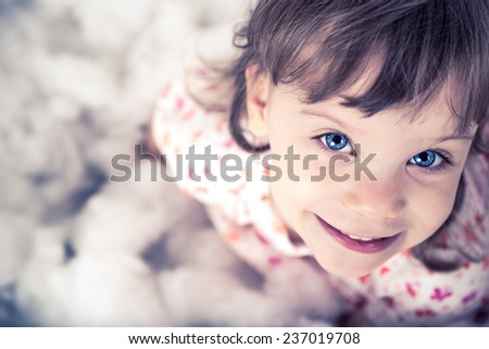 Portrait of a lovely little girl lookit at camera - stock photo