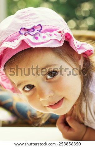 Portrait of a lovely little girl outdoors - stock photo