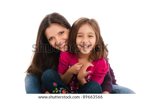 portrait of a lovely little girl with her elder sister, smiling, isolated on white background