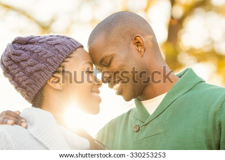 Portrait of a lovely smiling young couple on an autumns day