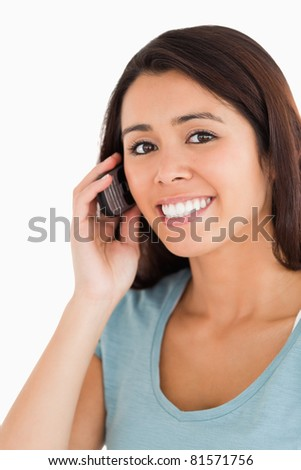 Portrait of a lovely woman on the phone standing against a white background