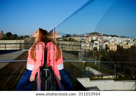 Portrait of a lovely young hipster girl enjoying the sun and tranquility outdoors while standing against copy space area for your text message or advertising content,woman relaxing in sunny summer day - stock photo