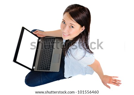 Portrait of a lovely young woman working on laptop with copy-space while sitting on the floor isolated on white