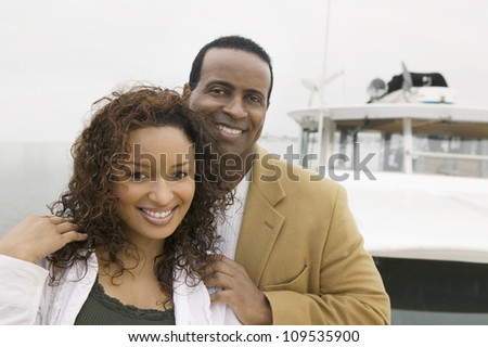 Portrait of a loving African American couple on the yacht during vacation