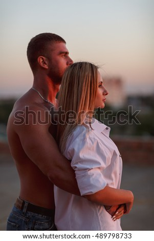 Portrait of a loving couple against a beautiful sunset