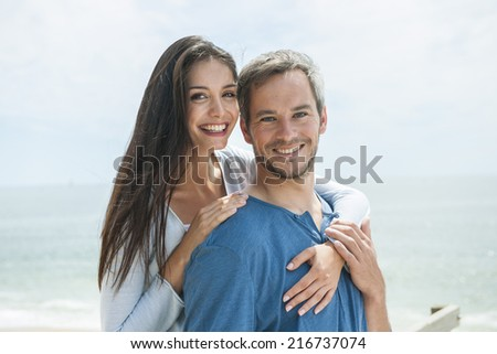 portrait of a loving couple before the sea in summertime