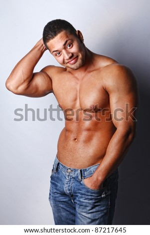Portrait of a macho man against grey background
