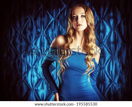 Portrait of a magnificent young woman with beautiful wavy hair. Fashion shot. - stock photo