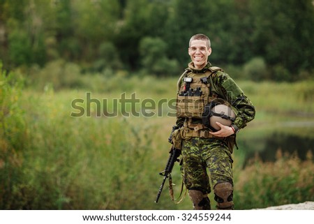Portrait of a male American US special forces soldier smiling - stock photo