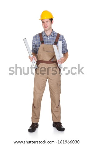 Portrait Of A Male Architect Holding Blueprints On White Background