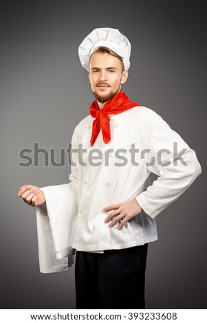 Portrait of a male chef cook in uniform. Occupation. Studio shot.  - stock photo