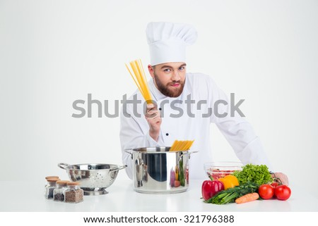 Portrait of a male chef cook preparing pasta isolated on a whtie background - stock photo