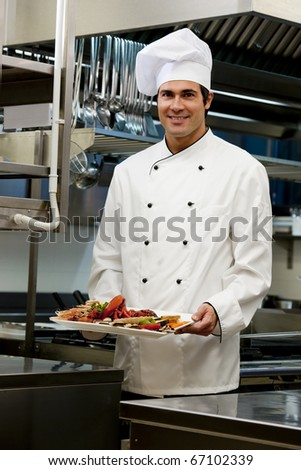 Portrait of a male chef in the restaurant