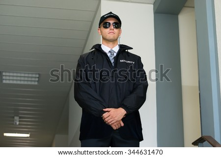 Portrait Of A Male Confident Security Guard With Sunglasses - stock photo