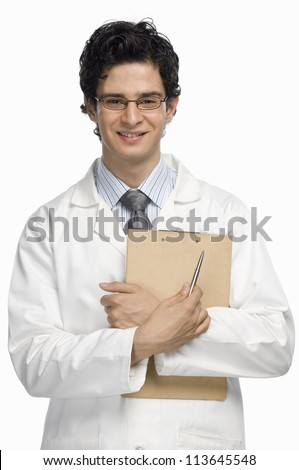 Portrait of a male doctor holding a clipboard - stock photo