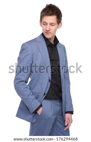 Portrait of a male fashion model in business suit standing on isolated background