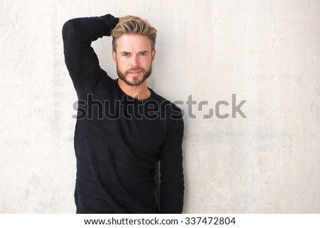 Portrait of a male fashion model posing with hand in hair - stock photo