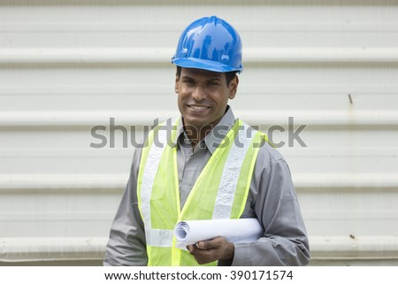 Portrait of a male Indian builder or industrial engineer at work.