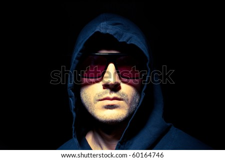 Portrait of a male model in the dark - stock photo