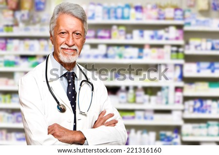 portrait of a male pharmacist at pharmacy - stock photo
