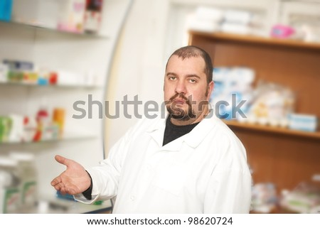 Portrait of a male pharmacist at pharmacy. Medicine - stock photo