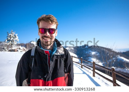 Portrait of a male skier - stock photo