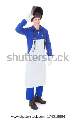 Portrait Of A Male Welder With Protective Workwear Over White Background - stock photo