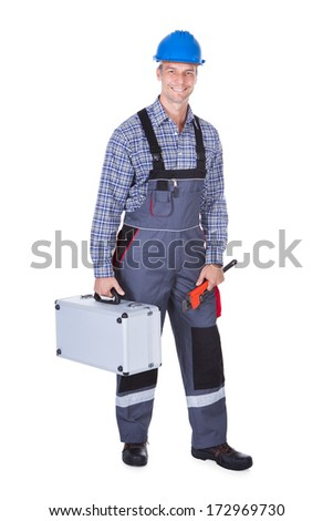 Portrait Of A Male Worker With Toolkit Isolated Over White Background - stock photo
