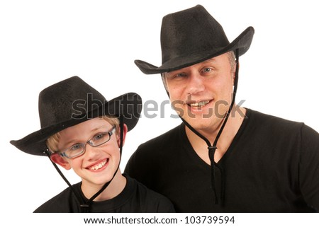 Portrait of a man and a little boy with cowboy hats - stock photo