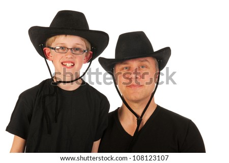 Portrait of a man and a little boy with cowboy hats