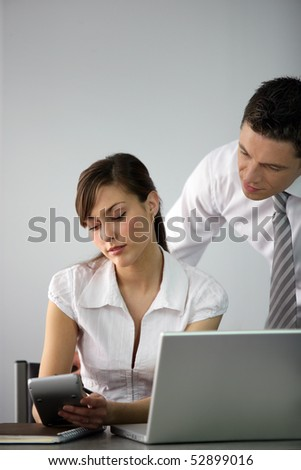 Portrait of a man and a woman in front of a laptop computer - stock photo