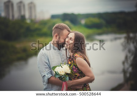 portrait of a man and woman with flowers in nature
