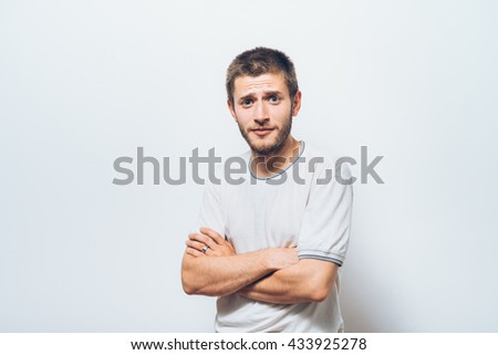 Portrait of a man arms folded - stock photo