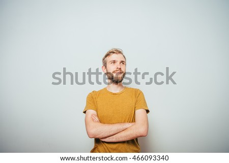 Portrait of a man arms folded