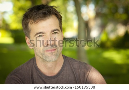 Portrait of a Man At The Park - stock photo