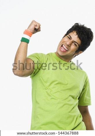 Portrait of a man clenching fist - stock photo