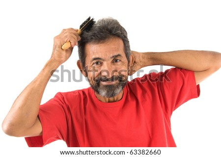 portrait of a man combing hair .