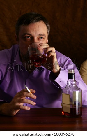 portrait of a man drinking and smoking - stock photo