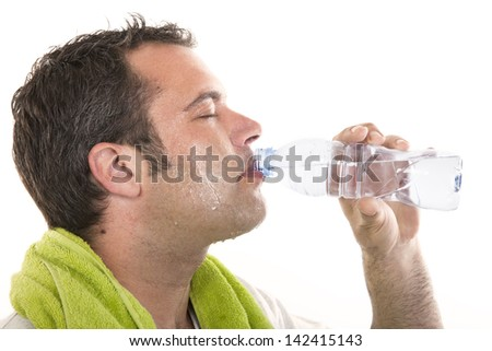 portrait of a man drinking waterand and sweating after sports