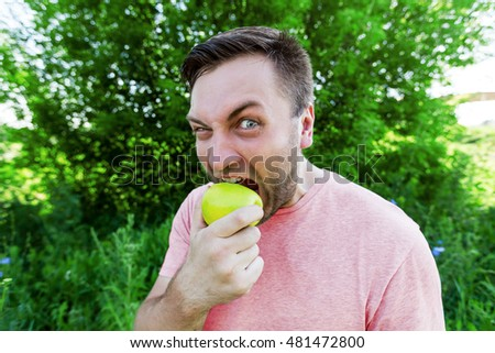 Portrait of a man eating an apple