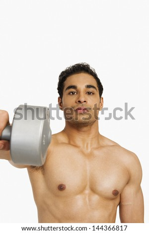 Portrait of a man exercising with a dumbbell