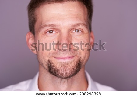 Portrait of a man expressing different emotions