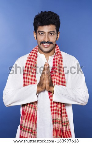 Portrait of a man greeting - stock photo