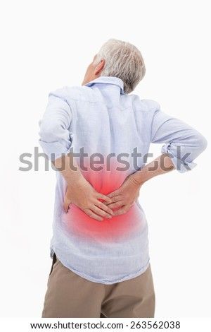 Portrait of a man having a back pain against a white background - stock photo