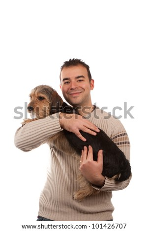 Portrait of a man holding a cute mixed breed dog isolated over white.