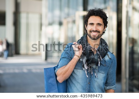 Portrait of a man holding a shopping bag